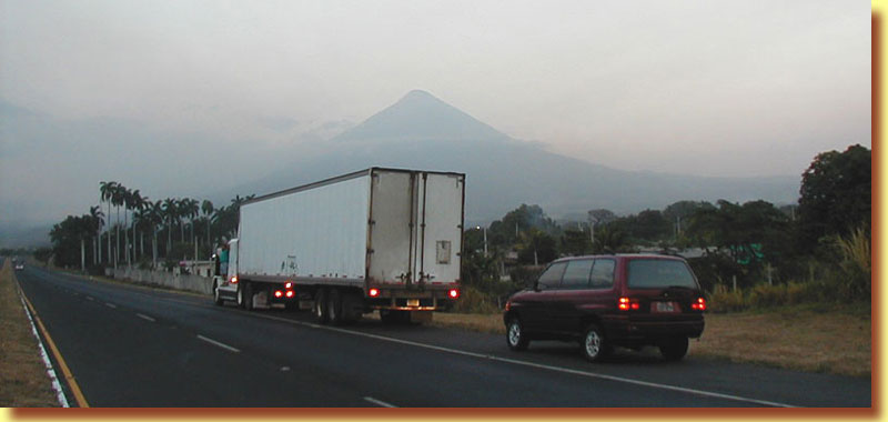 ... lovely weather and beautiful Guatemala scenery, almost home in Antigua ... the highway from Escuintla to Guatemala City.  Antigua is just the other side of Volcano Agua.